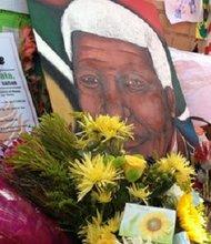 Makeshift tribute wall for Mandela outside the hospital where he has been since June 8.