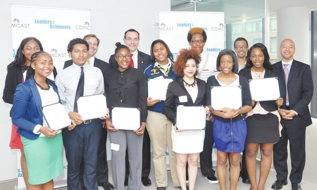 District of Columbia students received 2013 Comcast Leaders and Achievers scholarships earlier this spring. They gathered for a group shot with John Conwell, vice president of Government and Community Affairs for Comcast; D.C. Mayor Vincent C. Gray; and Thomas Tucker, senior director of Government and Community Affairs for Comcast. (Courtesy of Comcast)
