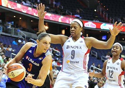 Phoenix Mercury's Diana Taurasi drives to the basket past Washington Mystics players Kai Vaughn and Ivory Latta on Thursday, June ...