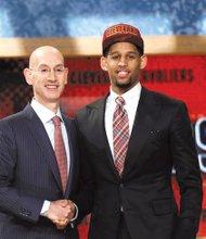 Allen Crabbe with NBA Commissioner Adam Silver.