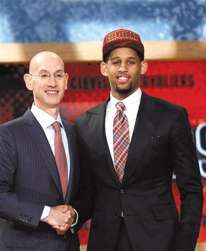 Allen Crabbe with NBA Commissioner Adam Silver.
