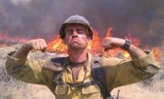 "Andrew Ashcraft, 29, is one of the nineteen members of an elite Arizona wildfire-fighting unit that was killed Sunday, June 30, 2013. This photo shows him fighting the fire on Saturday. His mother, Deborah Pfingston, told CNN's Brian Todd, ""He loved being a hot shot. He wanted to do hot shot work until he physically no longer could do it. He trained feverishly."""