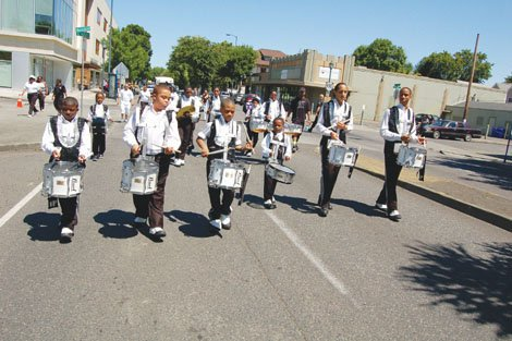 Drumline 2013 Division Champions show off their skills in Saturday's Good in the Hood parade on Northeast Martin Luther King Jr. Blvd.