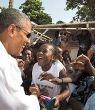 Obama greets youngsters on Goree Island in Dakar, Senegal.