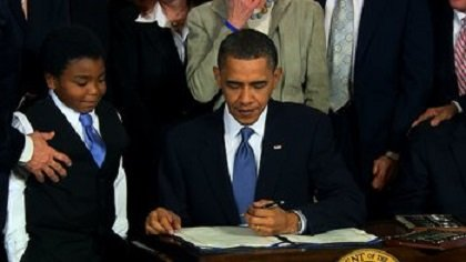 President Barrack Obama signs into law a sweeping bill overhauling the U.S. medical system at the White House on March 23, 2010. Among other provisions, the law requires most Americans to purchase health insurance.