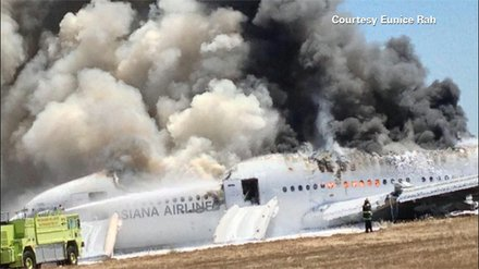 The aftermath of Asiana Airlines flight 214 with 307 people on board, originated in Shanghai, China, and stopped in Seoul, South Korea. It was preparing to land in San Francisco when the rear of the plane struck the edge of the runway, severing the tail and causing the plane to erupt in smoke and flames.