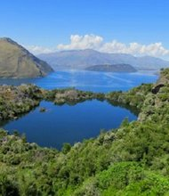 Near the center of pristine alpine Lake Wanaka, on New Zealand's southern island, Mou Waho is a glacial remnant of the last Ice Age.
