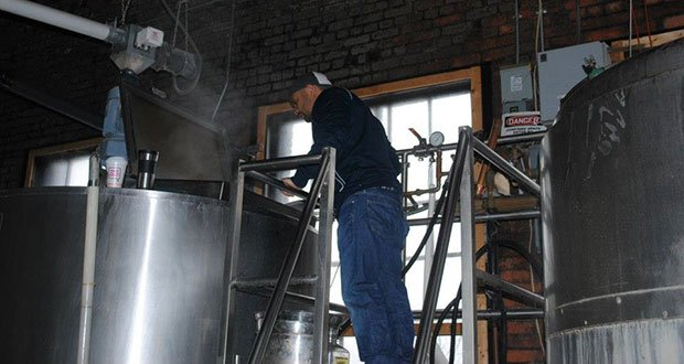 Percival Beer Company's Felipe Oliveira at Paper City Brewery in Holyoke, where his company's beer is made.