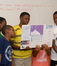 Campers at the Beat the Streets STEM/Wrestling camp present their research.