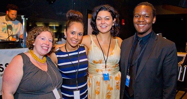 Press Pass TV's co-directors and alumni celebrate the organizations fifth anniversary. (L-R) Co-director Cara Berg Powers, alumna Avelyn Pires, co-director Joanna Marinova, and alumnus Reggie Williams.
