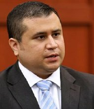 George Zimmerman talks to court personnel during a recess on the 16th day of his trial in Seminole circuit court, in Sanford, Fla., Monday, July 1, 2013. Zimmerman is accused in the fatal shooting of Trayvon Martin.