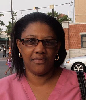 """""""I have an air conditioner, I'm keeping myself hydrated, I wear a hat, sunscreen, shades and I lessen my activity."""" — Dionne Black, Certified Home Health Aide, Mission Hill"""