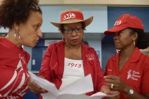 From left: Delta Sigma Theta members Brenda Hammond, Sarah Davidson and Karen Clark strategize a welcoming plan for arriving members at Union Station in Northeast on the opening day of the organization's 51st Convention on Thursday, July 11.