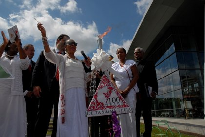 Hundreds of people gathered in Baltimore's Inner Harbor on Friday, July 5, 2013 to welcome the Delta Sigma Theta Sorority's ...
