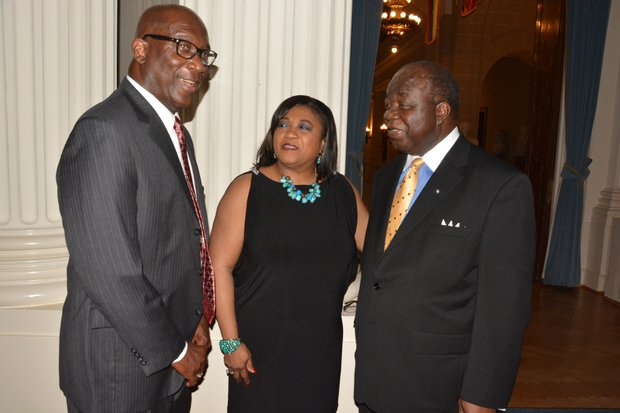 Elliston Rahming (right), the Bahamas' Ambassador to the United States, and Consul General Paulette Adderley Zonicle (center) talk during a celebration of the 40th anniversary of the Commonwealth of the Bahamas' independence at the Hall of the Americas OAS headquarters in Northwest D.C. on July 10, 2013.
