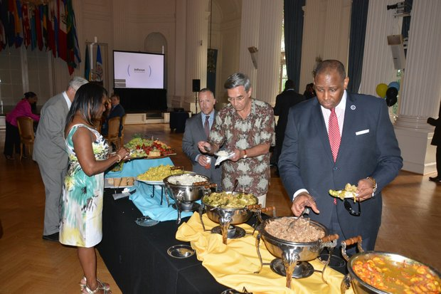 George Holmes samples the food during a celebration of the 40th anniversary of the Commonwealth of the Bahamas' independence at the Hall of the Americas OAS headquarters in Northwest D.C. on July 10, 2013.