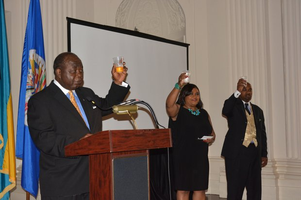 Elliston Rahming (left), the Bahamas' Ambassador to the United States, and Consul General Paulette Adderley Zonicle raise their glasses for a toast during a celebration of the 40th anniversary of the Commonwealth of the Bahamas' independence at the Hall of the Americas OAS headquarters in Northwest D.C. on July 10, 2013.
