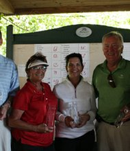The winning foursome (Left to right) Joe Flynn, Kathy Pinacci, Paula Renner, Bob Zupko with Reginald Broddie.
