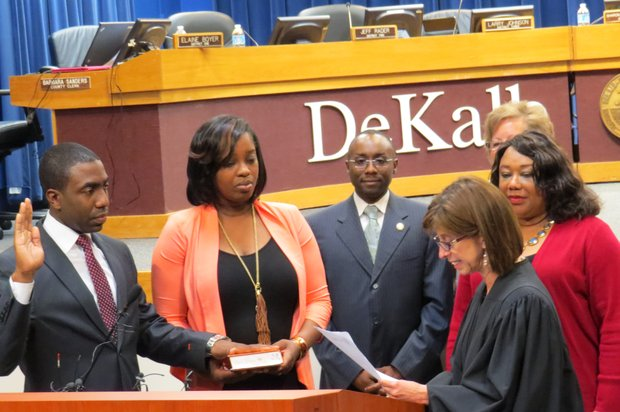 District 5 Commissioner Lee May (left) is sworn in as DeKalb's interim CEO by Judge Jeryl Rosh while his wife, Robin, and Commissioners Larry Johnson, Elaine Boyer and Sharon Barnes Sutton look on.