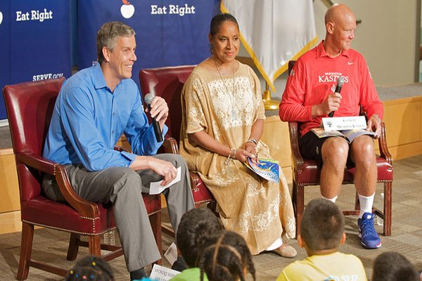 "Secretary of Education Arne Duncan ((left) was joined by actress Phylicia Rashad and Murphy Jensen, Washington Kastles World Tennis team coach, in hosting his agency's second ""Let's Read! Let's Move!"" event on July 17."