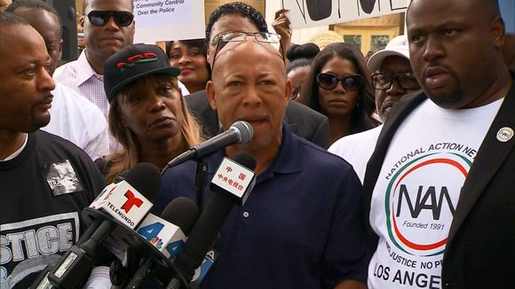 The parents of Trayvon Martin joined thousands of Americans at more than 100 scheduled vigils in cities nationwide demanding Saturday ...