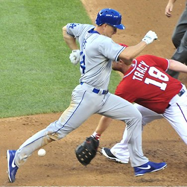 Nationals first baseman Chad Tracy is late collecting the baseball as Dodgers pitcher Zack Greinke makes it safely onto first base on Saturday, July 20 at Nationals Park in Southeast. The Dodgers defeated the Nationals 3-1 before a sellout crowd.