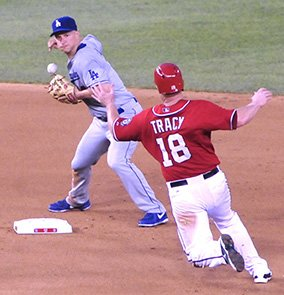 Nationals first baseman Chad Tracy is late getting to second base as Dodgers second baseman Mark Ellis attempts a double play on Saturday, July 20 at Nationals Park in Southeast. The Dodgers defeated the Nationals 3-1.