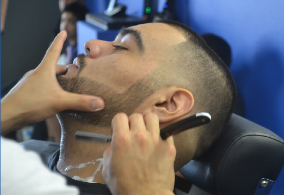 Five Star Barbershop opened in grand fashion offering food, music and best of all, one-dollar haircuts!