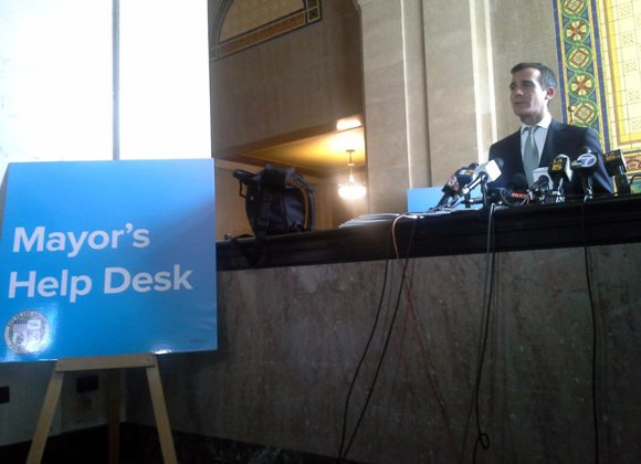 Los Angeles Mayor Eric Garcetti opens help desk at City Hall.
