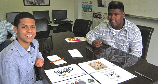 (L-R) Youth entrepreneurs Anthony Nin and Angel Soto discuss theircompany, ReVamp'D,at the Boston office of BUILD. ReVamp'D won BUILD's Business Youth Business Plan Competition.