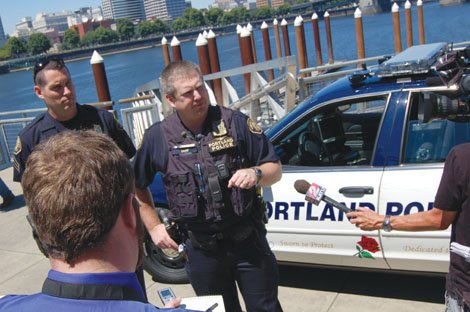 Officer Garrett Dow explains how Portland Police are using high-tech license plate scanners [pictured behind him on a police squad car] in an effort to reduce crime. The press conference was held last Wednesday after the American Civil Liberties Union reported on use of the new technology nationwide and questioned how the technology infringes on privacy issues.