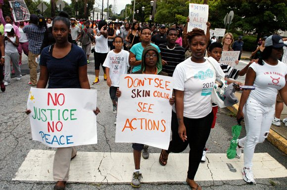 Two national opinion polls released July 22 revealed a dramatic racial divide in public opinion surrounding the Trayvon Martin case, ...