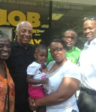 Gail Hilton and James Hilton pose with the Man Up! founder and CEO Andre T. Mitchell and Councilman Charles Barron and Assembly member Inez Barron. Their son, 23-year-old James Hilton, was shot and killed a year ago. Gail is holding her late son's daughter, Jashaii Hilton, who proudly told the AmNews that she is 2 years old.
