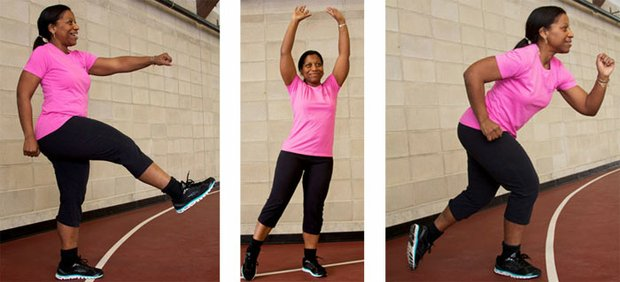 Carla Webster-Reid, a certified group fitness trainer, demonstrates the technique of walking in place.