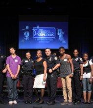 "Program founder Dr. Lenora Fulani and 12 ""cops and kids"" demonstrate the workshop for audience of 850 police and community."