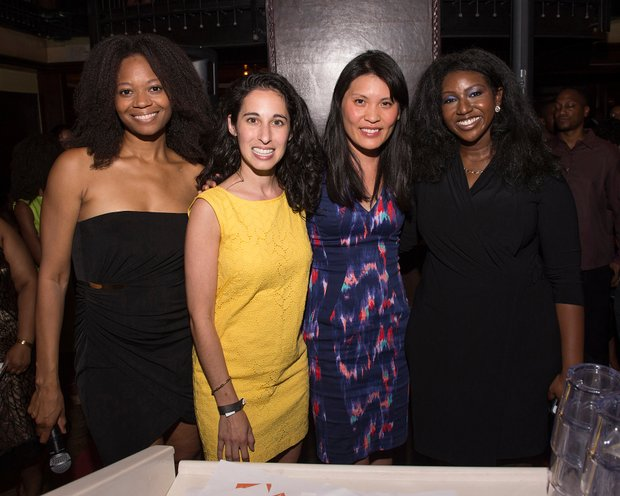 Ayme Sinclair (far left) and Maisha Walker (Far right) teamed up with representatives from charity website Donors choose to help fund public school programs throughout the city.