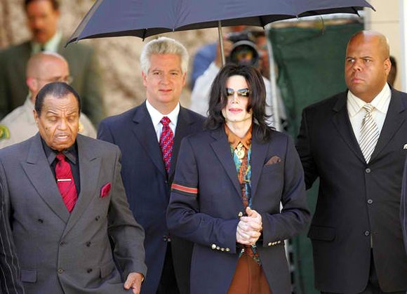 Joe Jackson, Brian Oxman, Michael Jackson and bodyguard.
