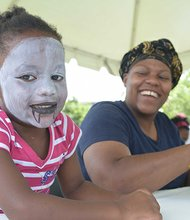 Three-year-old Naomi Peoples shows off her modern day vampire look while her mother, Marlene, gets a click out of her daughter's fictional character visage, during the Arts & Humanities Festival at St. Elizabeths East on Saturday, July 27.