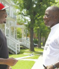 Sherman Justice and Courtney Stewart engage in lively conversation on July 20. Stewart, the founder and chair- man of the nonprofit organization Reentry Network for Returning Citizens, pounded the pavement and knocked on doors in Southwest, in the hopes of registering returning citizens to vote.