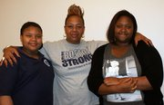 Celeste Hayden (middle) and her two daughters took part in the FUEL Education program at the Boston Public School Parent University in Boston.