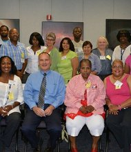 Instructors from multiple school districts in D.C., Prince George's County and Baltimore City participate in a three-day development workshop at NASA's Goddard Space Center in Greenbelt for the STEM Enrichment Professional Development program. Seated in the center is Richard Hieb, vice president of Lockheed Martin, which co-sponsored the event.