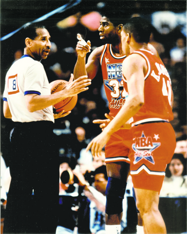 Long time retired NBA official Lee Jones interacting with Magic Johnson. Jones will be inducted into the New York City Basketball Hall of Fame on Thursday, Sept. 19 at the New York Athletic Club.