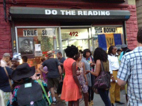 On a small section of the bustling Nostrand Avenue in Bed-Stuy on Wednesday, July 24, a tightly packed crowd gathered ...