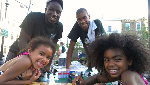 """7 year old Aleia and 10 year old Anaylee attended Mayor Menino's free chess workshop in Roxbury on July 15. They spent the evening at a game table at Alvah Kittredge Park learning how to play chess with tips offered by staff from the Boston Parks and Recreation Department. The event is part of the Mayor's """"Knights in the Parks"""" program which features chess this summer at Kittredge and Howes Parks. The Boston Parks Department hosts more than 150 free events each year and is a partner with the National Recreation and Park Association and the National Wildlife Federation in """"10 Million Kids Outdoors"""", an initiative to get 10 million more children outside to reconnect with nature in the next three years and reap the health benefits of having an active lifestyle. For a list of programs, please visit:www.cityofboston.gov/parks"""