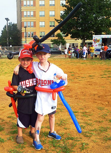 Decked-out brothers Danny, 5, and Matthew Tobin, 7, of West Roxbury are thrilled to enjoy giveaways including balloons, tattoos, and food at the ParkARTS Neighborhood Concert at Carter Playground on July 22.  Mayor Menino's Neighborhood Concerts feature a variety of music styles at various parks throughout Boston until August 4.  The event was sponsored by the Boston Parks and Recreation Department in partnership with Bank of America and the Office of City and Community Affairs at Northeastern University.  For information on more Boston Parks and Recreation Department events, please visit www.cityofboston.gov/parks.