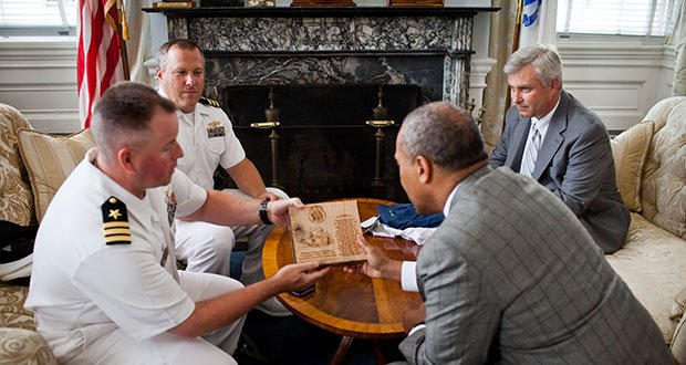 "Monday, July 22, 2013 - Governor Patrick holds a courtesy meeting to welcome the incoming captain of the USS Constitution, Commander Sean Kearns, and gives thanks to the outgoing captain, Commander Matthew Bonner who presented the Governor with a piece of wood from the USS Constitution inscribed with the poem ""Old Iron Sides"""