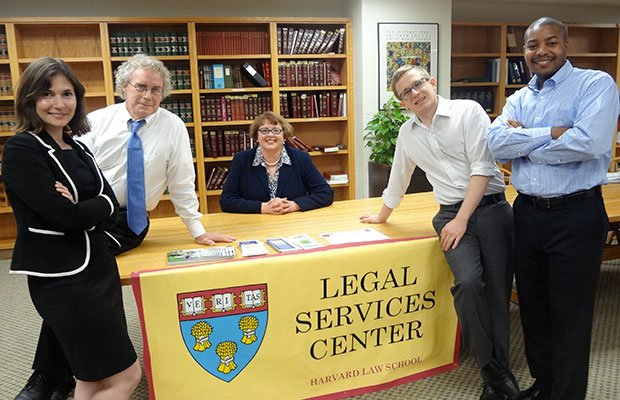 The Legal Services Center of Harvard Law School has started an anti-foreclosure and eviction-defense program, called the Mattapan Initiative, which will provide free legal services. Team members include (L-R) Julia Devanthery, a post-foreclosure eviction-defense attorney; Roger Bertling, overseeing attorney for the Mattapan Initiative; Maureen McDonagh, attorney; Charlie Carriere, a predatory lending/pre-foreclosure attorney; and Brandon German, community outreach coordinator.