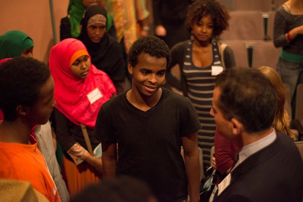 Mayoral candidate Mike Ross entertains questions from students in the African Community Economic Development of New England organization (ACEDONE).