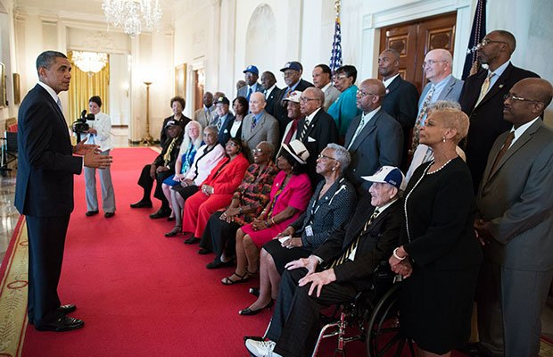 President Barack Obama meets with former Negro League baseball players in the Cross Hall of the White House, Aug. 5, 2013.