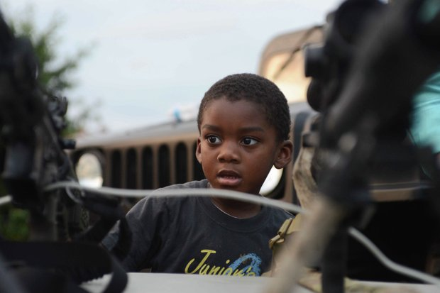 Dorian Griffin Jr., 4, looks on during a demonstration by the Laurel, Md., Police Department SWAT team at the town's annual National Night Out in Granville Gude Park on Tuesday, Aug. 6. The yearly event gives Laurel's law enforcement and rescue personnel an opportunity to meet with the community.